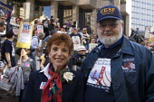 Antonia Cortese of the AFT and Dennis Kelly, pres of UESF. Union members march through downtown San Francisco to protest at attacks on public sector unions in Wisconsin and other states, and cuts in p... - David Bacon - 04-04-2011