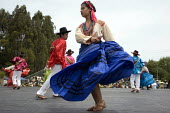 California, Dancers from the many ethnic groups of Oaxaca, now living as migrants in the USA, at the annual festival of Oaxacan indigenous culture, the Guelagetza Festival. This Guelagetza takes place... - David Bacon - 22-05-2011
