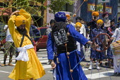 During the parade dancers spin webs of ropes and balls. Sikhs parade through the streets of Berkeley California on the anniversary of the death of Guru Arjan Dev Ji, which is celebrated as a day of pe... - David Bacon - American,2010s,2011,ACE,America RLB,American,americans,anniversary,Arjan,Asian,asians,BAME,BAMEs,Belief,Black,BME,bmes,California,culture,dance,dancer,dancers,dancing,death,DEATHS,Dev,Diaspora,died,di