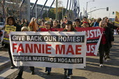 California: Activists from Causa Justa: Just Cause and Occupy Oakland protest against foreclosures, and demand that banks and Fannie Mae allow families to move into foreclosed and vacant homes they ho... - David Bacon - 06-12-2011
