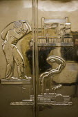 Saint Paul, Minnesota. One of the six bronze elevator doors in the lobby of St. Paul City Hall, designed by New York artist Albert Stewart and installed in 1936, that depict St. Paul history and life... - David Bacon - 12-04-2012