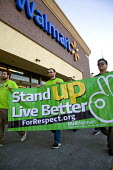California: Workers at the San Leandro Walmart store walk out of work, organised into Our Walmart - for respect at work- they demonstrate with supporters, and then walk back into the store to place fl... - David Bacon - 2010s,2012,activist,activists,against,America,at,banner banners,break,bullying at work,campaign,campaign campaigning,campaigner,campaigners,CAMPAIGNING,CAMPAIGNS,de recognition,DEMONSTRATING,demonstra