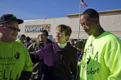 California: Mary Kay Henry Pres of the SEIU talking with workers Raymond Bravo and Dominic Ware. Workers at the Walmart store in Richmond are joined by other Walmart workers sacked for their union mem... - David Bacon - 2010s,2012,activist,activists,against,America,at,BME black,bullying at work,campaign,campaign campaigning,campaigner,campaigners,CAMPAIGNING,CAMPAIGNS,communicating,communication,communities,community