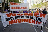 Women gave birth to the movements banner. Immigrants, workers, union members and community activists marched on May Day in San Jose. Marchers protested at discrimination against immigrants, unions and... - David Bacon - , American,2010s,2013,ACTIVIST,activists,against,America,American,americans,anger,Asian,banner,banners,birth,CAMPAIGN,campaigner,campaigners,CAMPAIGNING,CAMPAIGNS,crowd,DEMONSTRATING,demonstration,DEM