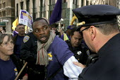 SAN FRANCISCO, Security guards march through downtown San Francisco, and then sit in and block a road intersection to protest at the unwillingness of security companies to negotiate a fair union contr... - David Bacon - 04-10-2007
