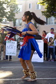 OAKLAND, California - Aztec dancers perform as Immigrants, workers, union members and community activists demonstrate in front of the Mi Pueblo market in Oakland against the firing of undocumented wor... - David Bacon - 12-06-2013