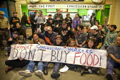 SAN FRANCISCO, California- Workers who serve food at the concession stands at AT&T Park, the baseball park for the San Francisco Giants, sit-in with supporters at the Garlic Fries concession. The work... - David Bacon - 18-06-2013