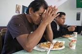 Berkeley, California: Day laborers get food and eat lunch at the Multicultural Institute in Berkeley, which provides food programs for poor people. Many of the day laborers are immigrants from Mexico... - David Bacon - 01-11-2013