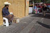 Mexico City a farmworker selling packets of coffee from a little stall on the street. - David Bacon - 30-01-2014