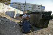 Tijuana, Mexico, homeless woman collecting cans and plastic from garbage dumpsters - David Bacon - ,2010s,2014,americas,bag,bags,bottle,bottles,camp,camps,cities,city,collecting,Diaspora,discarded,dispose,dumpster,EQUALITY,excluded,exclusion,FEMALE,foreign,foreigner,foreigners,garbage,HARDSHIP,home