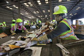 California- Workers sort and process paper, cardboard, plastic, and glass from waste collected in local cities. Alameda County Industries - David Bacon - 18-02-2015