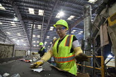 California- Workers at the recycling sorting facility of Alameda County Industries sort and process paper, cardboard, plastic, glass and metal from trash collected in local cities. - David Bacon - 18-02-2015