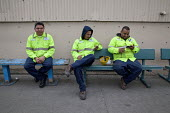 California- Workers at the recycling sorting facility of California Waste Solutions take a break. - David Bacon - American,2010s,2015,America,American,americans,BAME,BAMEs,BME,bmes,break,break time,breaktime,California,call,calls,capitalism,capitalist,CELLULAR,communicating,communication,CWS,Diaspora,DINNER,dinne