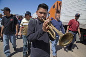 Cananea, Sonora, Mexico, The drum and bugle corps of Striking miners march at the Cananea copper mine occupying a pumping station, which has shut down mine operations. They are joined by residents and... - David Bacon - 26-03-2015