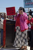 Cananea, Sonora, Mexico, Martha Patricia Velarde Ortega, leader of the local community resisting the contamination of the river, speaking at a rally. Striking miners march at the Cananea copper mine o... - David Bacon - 26-03-2015