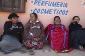 Mexico, Indigenous women wait as farm workers demonstrate their support for their independent association, The Alianza. Leaders try to negotiate wage increases with the government. The workers are alm... - David Bacon - 04-06-2015