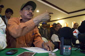 Mexico, Fermin Salazar a leader of The Alianza at a press conference to announce the results of the negotiation with the government to increase wages of farm workers. The workers are almost all indige... - David Bacon - 04-06-2015