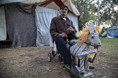 "Tijuana, Baja California Norte, Mexico, Felipe Gomez, a former baker on a toy horse Finally Mexican President Pea Nieto Came Out of the Closet!"" Homeless camp in the Benito Juarez Park, next to Tijuan... - David Bacon - 02-06-2015"