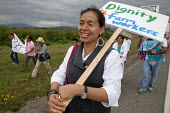Blanca Velasquez a AFL-CIO organiser with farm workers demanding Trade Union recognition march to Sakuma Farms, a large berry grower in Washington. The workers and their supporters are demanding that... - David Bacon - 11-07-2015