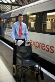 National Express East Coast main line staff, working at Kings Cross Station, London - Duncan Phillips - 2000s,2008,adult,adults,assist,assisting,boarding,bound,carriage,carriages,cities,city,coast,coastal,coasts,commute,commuter,COMMUTERS,COMMUTING,cross,disabilities,disability,disable,disabled,disablem