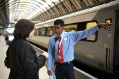 National Express East Coast main line staff, working at Kings Cross Station, London - Duncan Phillips - 2000s,2008,adult,adults,asian,asians,assist,assisting,BAME,BAMEs,Black,BME,bmes,carriage,carriages,cities,city,coast,coastal,coasts,commute,commuter,COMMUTERS,COMMUTING,cross,diversity,east,EBF,Econom