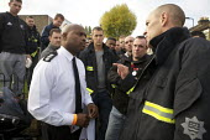 London fire strike, Picket Tottenham Fire Station. Working Firefighter Daniel Alie a Station manager Hornsey Fire Station, talks to stiking firefighters - Duncan Phillips - 01-11-2010