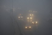 Traffic driving in heavy Fog, London. - Duncan Phillips - 2000s,2006,adult,adults,AUTO,AUTOMOBILE,AUTOMOBILES,AUTOMOTIVE,car,cars,christmas,cities,city,cold,COMMUTE,commuter,commuters,commuting,conditions,congested,congestion,danger,DANGEROUS,DRIVER,DRIVERS,