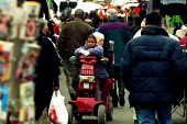 Shopper with child on electric buggy Chapel Market Islington - Duncan Phillips - 05-12-2001