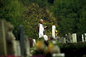 Priest reading Last rites East Finchley Cemetery London - Duncan Phillips - 15-06-2002