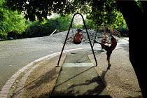 Children on swings islington London - Duncan Phillips - 2000s,2002,Child,CHILDHOOD,Children,cities,city,Council Services,Council Services,families,FAMILY,ground,in,islington,juvenile,juveniles,kid,kids,LEISURE,LFL leisure,local authority,London,on,outdoors