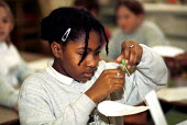 Primary school student conducting a science experiment - Duncan Phillips - 25-10-2001