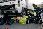 Emergency Services rescuing a pedestrian trapped under a lorry. London - Duncan Phillips - 12-10-2000