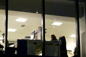 Office worker working late in City of London. - Duncan Phillips - 24-01-2012