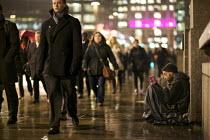 Homeless man begging in the rain, London Bridge, London. - Duncan Phillips - 24-01-2012