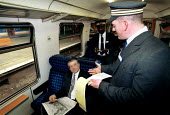 Revenue protection officers checking a passengers ticket.  The passenger is posed by an employee. - Duncan Phillips - 28-11-2002