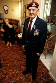 WW2 Veteran John Chandler at home with his medals - Duncan Phillips - 10-12-2002
