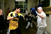 Boxing training at Boxing Gym islington London - Duncan Phillips - 2000,2000s,adolescence,adolescent,adolescents,bag,bags,bodybuilding,boxer,boxers,boxing,Boxing Gloves,cities,city,enjoying,enjoyment,exercise,exercises,exercising,fitness,fun,glove,Gym,gymnasium,gyms,