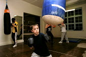 Boxing training at Boxing Gym islington London - Duncan Phillips - 2000,2000s,adolescence,adolescent,adolescents,bag,bags,bodybuilding,boxer,boxers,boxing,Boxing Gloves,child,CHILDHOOD,children,cities,city,enjoying,enjoyment,exercise,exercises,exercising,fitness,fun,