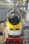 Eurostar Engineering Centre, Temple Mills, London. The facility is more than 400 metres long, and can take eight of Eurostar's 27-strong fleet of trains simultaneously. It cost �400million. - Duncan Phillips - 2000s,2007,carriage,carriages,cities,city,depot,DEPOTS,EBF Economy,engineering,eurostar,fleet,infrastructure,locomotive,LOCOMOTIVES,maintaining,maintenance,network,RAIL,railway,railway engine,RAILWAYS