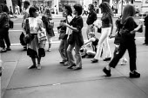 Woman walking down the street, New York City. USA - Duncan Phillips - 13-08-2002