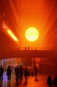 Visitors looking at Olafur Eliassons The weather project - huge fake sun in the turbine Hall Tate Modern. London - Duncan Phillips - 13-11-2003