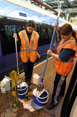 Cleaners cleaning trains prior to being put into service. East Ham Depot, London. - Duncan Phillips - 23-01-2003