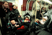 Mothers with children on a London Underground train. - Duncan Phillips - 15-01-2003