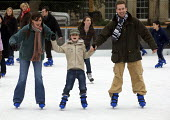 Ice Skating Parliament Fields, London - Duncan Phillips - 2000s,2006,adult,adults,balance,boy,boys,child,CHILDHOOD,children,christmas,cities,city,cold,DAD,DADDIES,DADDY,DADS,EMOTION,EMOTIONAL,EMOTIONS,enjoying,enjoyment,families,family,father,FATHERHOOD,fath