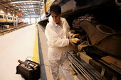 engineer working on Train. Bedford - Duncan Phillips - 2000s,2004,carriage,carriages,depot,DEPOTS,diagnostic,diagnostics,EBF economy,engineer,engineers,LAB LBR Work,maintaining,maintenance,network,people,RAIL,railway,RAILWAYS,rolling,rolling stock,stock,t