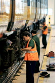Engineers working on a Train. Bedford - Duncan Phillips - 2000s,2004,carriage,carriages,depot,DEPOTS,EBF economy,employee,employees,Employment,engineer,engineering,engineers,job,jobs,LBR,maintaining,maintenance,network,people,RAIL,railway,RAILWAYS,rolling st