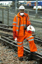 Network Rail welder. London - Duncan Phillips - 2000s,2004,BAME,BAMEs,black,BME,bmes,cities,city,depot,DEPOTS,diversity,EBF economy,engineer,engineers,ethnic,ethnicity,job,jobs,LAB LBR Work,London,maintaining,maintenance,minorities,minority,network