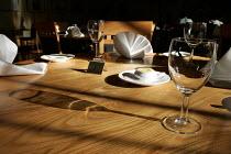 Wine glass in the sunlight on restaurant table - Duncan Phillips - 09-11-2004