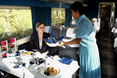 Steward serving breakfast on the ONE train service from Norwich to London - Duncan Phillips - 25-10-2004
