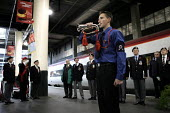 Sounding last post to members of the National Service veterans association. Remembrance service Euston station London - Duncan Phillips - 10-11-2004